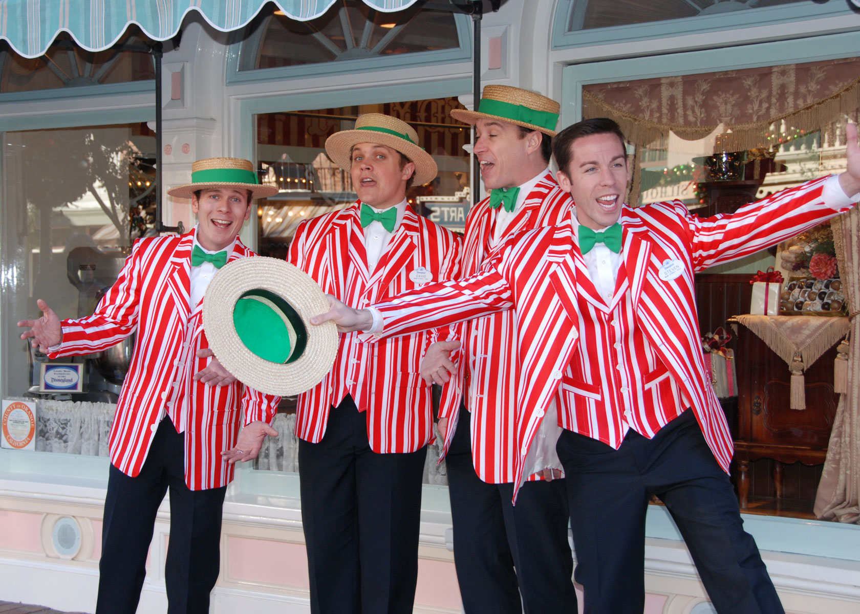 The barbershop quartet performs holiday songs on Main Street.
